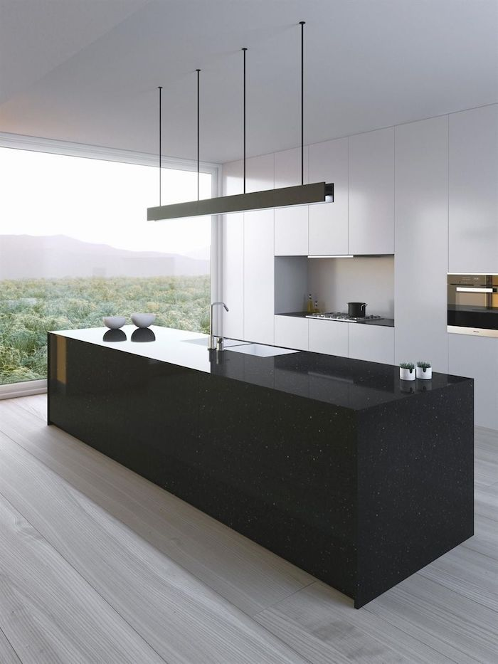 black kitchen island, wooden floor, beautiful kitchens, white cabinets and drawers, hanging lights