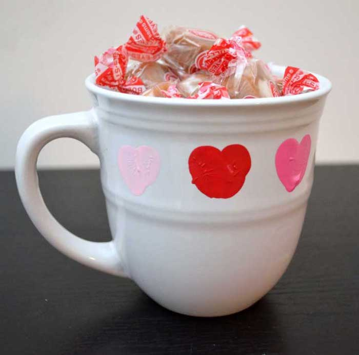 white mug filled with candy, heart shaped thumbprints, creative valentine's day gifts for boyfriend