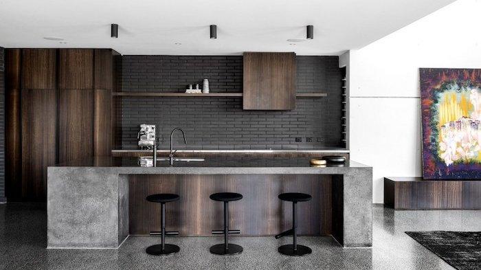 black bricks backsplash, kitchen ideas, black stools, wooden kitchen island and cabinets