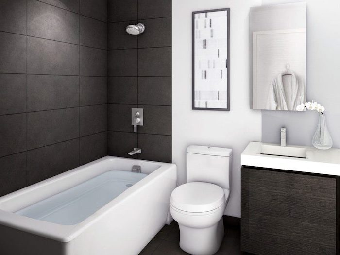 black tiled walls and floor, small bathroom design ideas, wooden cabinet under the sink, small mirror
