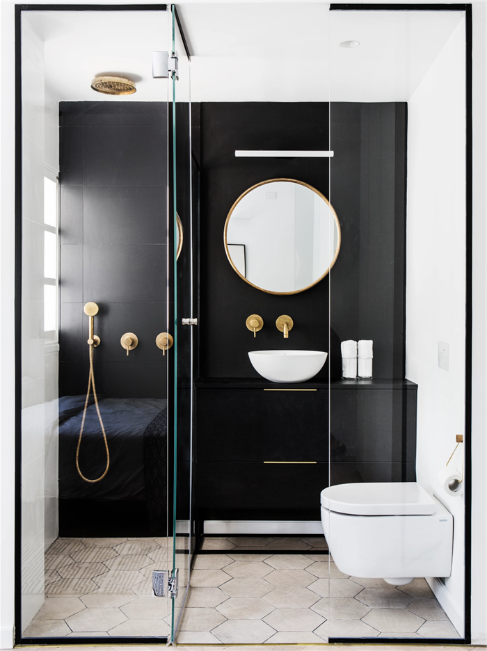 black tiled wall, white honeycomb tiled floor, glass shower door, bathroom shower ideas