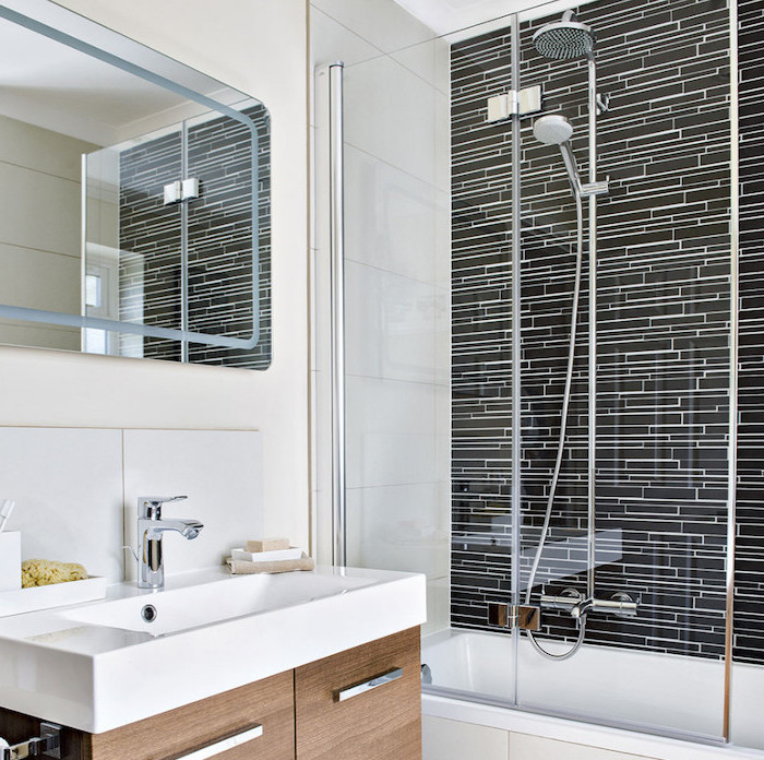 black and white tiled walls, wooden cabinet under the sink, small bathroom design ideas, small mirror