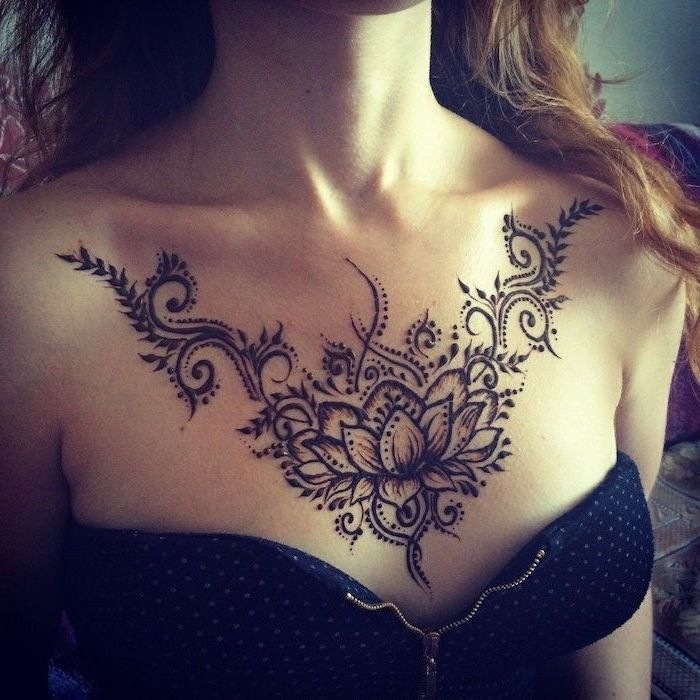black and white dotted top, lotus flower tattoo, girl chest tattoos, long brown hair