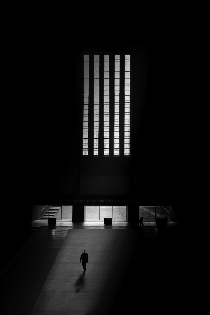 black background, best iphone wallpapers, lighting through windows, man walking