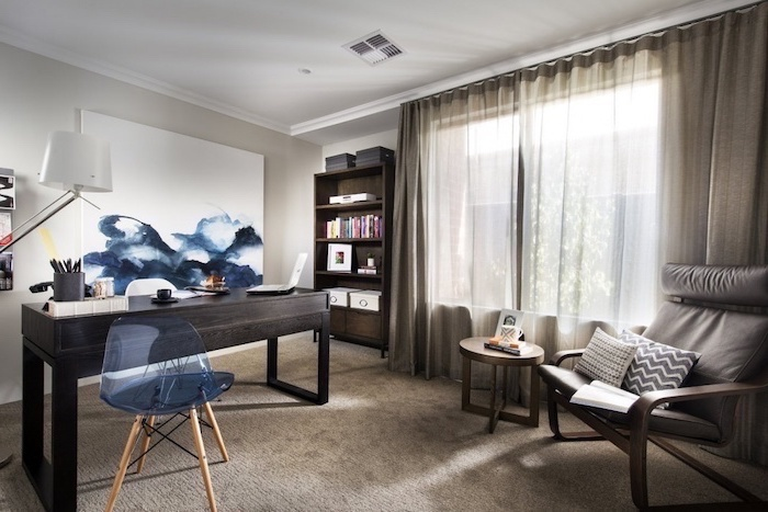 blue and white painting and chair, home office design, black wooden desk with white chair, grey leather armchair