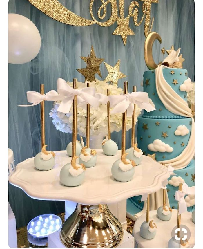 blue and gold moon cake pops, blue tulle, gold and white cake stand, baby shower party ideas