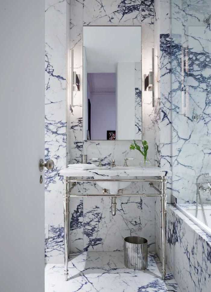 blue marble tiled wall and floor, metal floating sink, small bathroom design ideas, small mirror