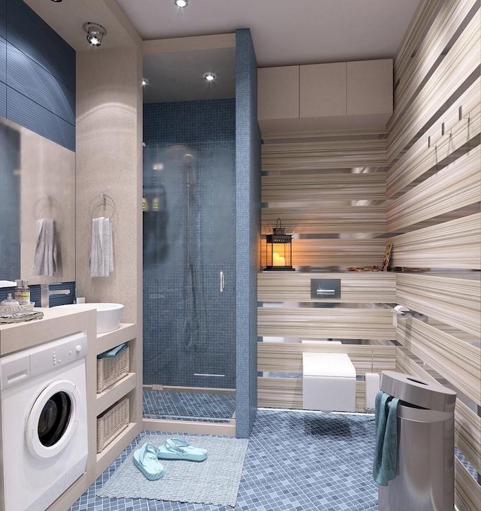 blue mosaic tiled walls and floor, wooden cabinets, washing machine, bathroom renovation ideas