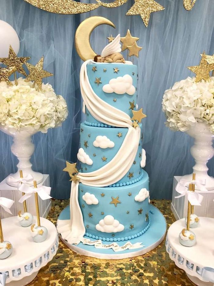 three tier blue cake, baby shower decoration ideas, little angel cake topper, white flower bouquets