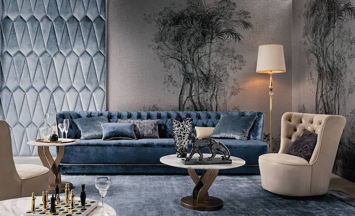 floral prints and blue velvet wall installation, blue velvet sofa and rug, beige armchair, accent wall ideas for living room