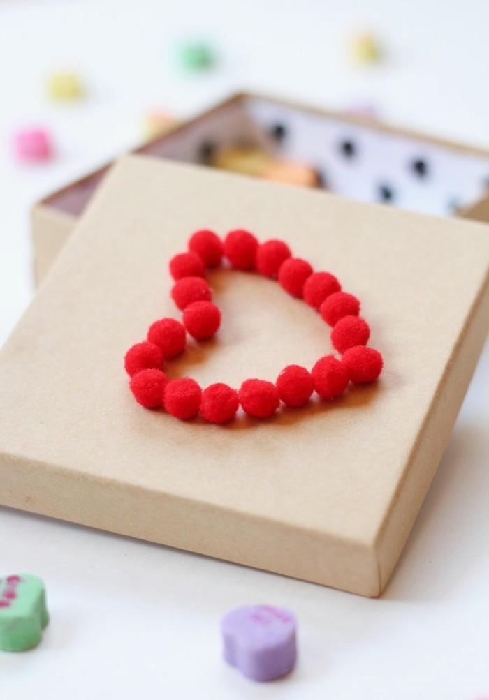 cardboard box, heart shaped pom poms, conversation hearts, gift basket ideas for boyfriend