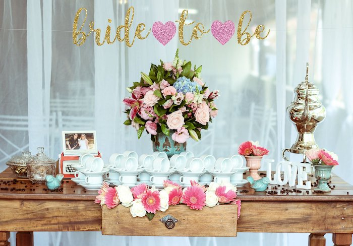 bride to be sign, large flower bouquet, wooden table, fun bachelorette party ideas