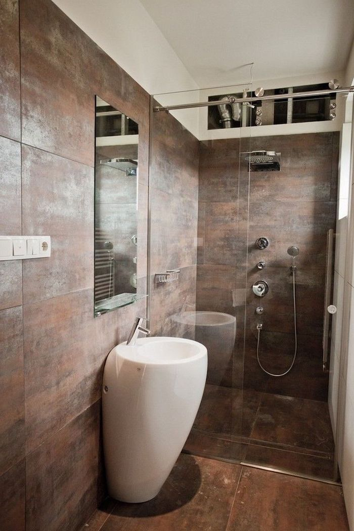 brown tiled floor and walls, glass shower door, how to decorate a small bathroom, oval white sink, small mirror