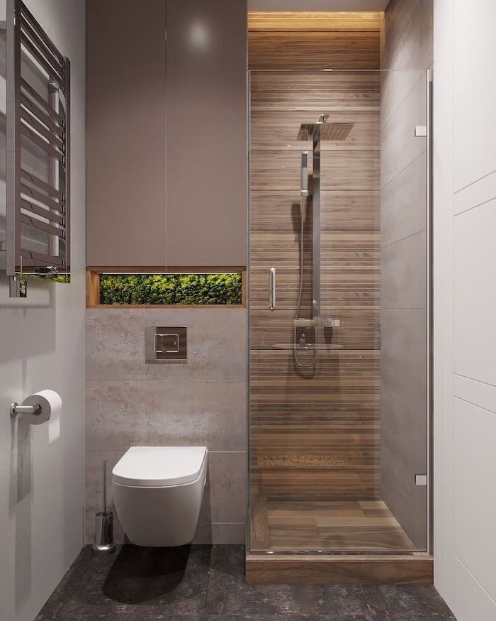 beige and grey tiled floor and walls, moss covered built in shelf, bathroom designs for small spaces, glass shower door