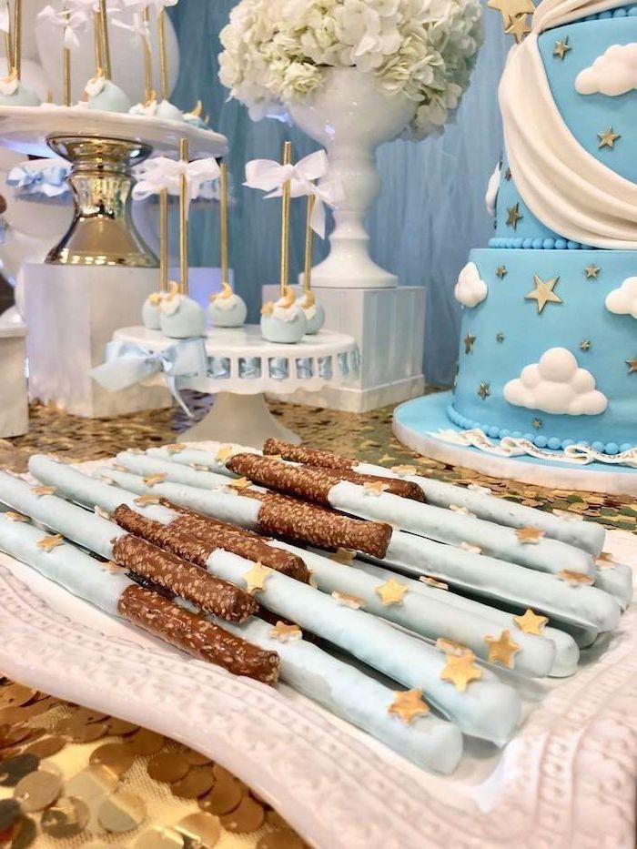 blue chocolate sticks, blue and golden moon cake pops, baby shower decoration ideas, blue cake