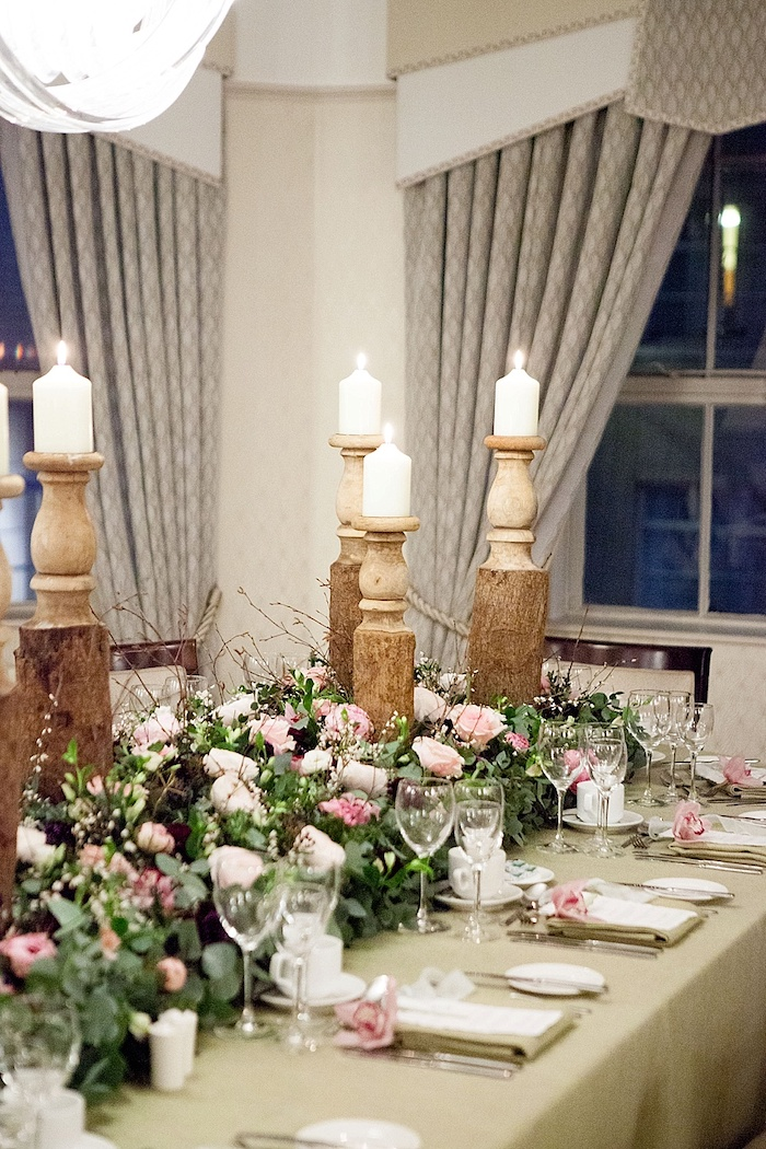 candlesticks with candles, pink and white roses flower arrangements, wedding reception decoration ideas