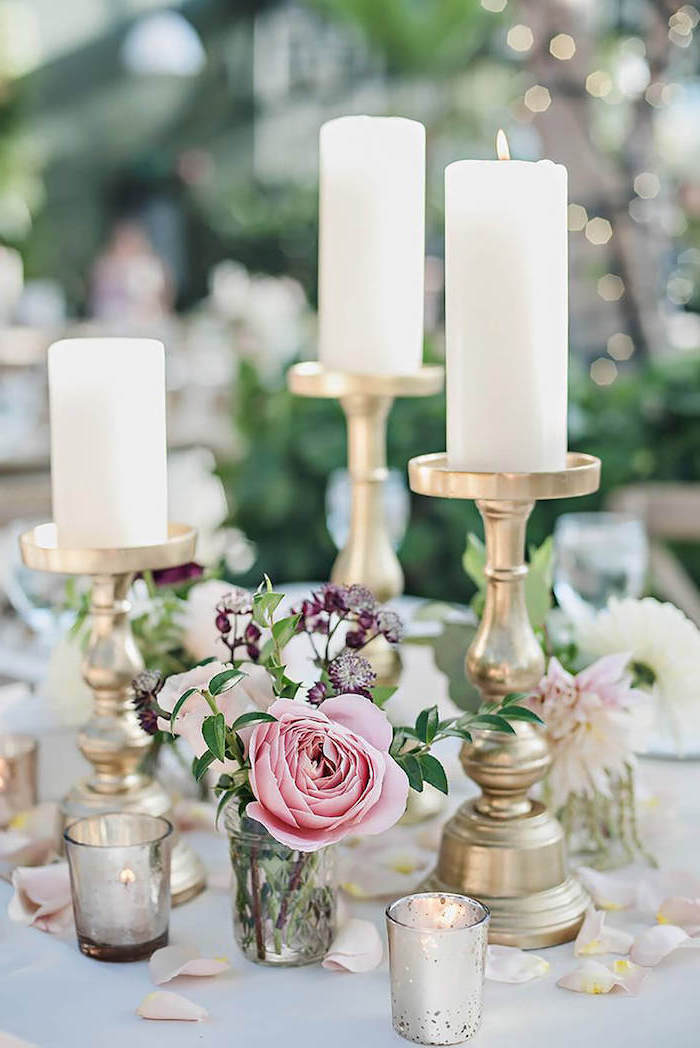 candlesticks with candles, rose petals on the table, white and pink roses flower bouquet in a small vase, diy wedding decorations