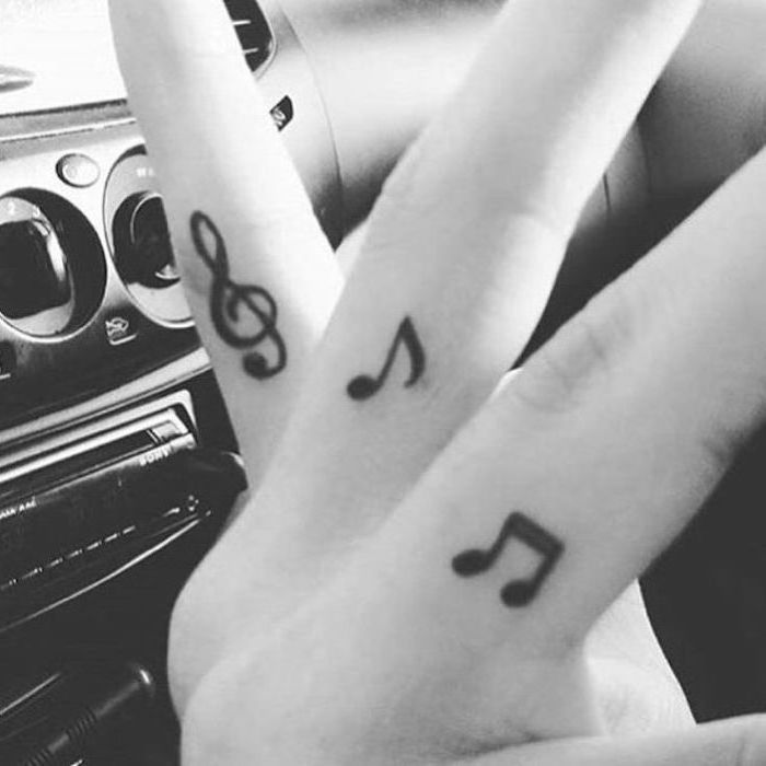 musical notes tattoos on the fingers, cute tattoos for girls