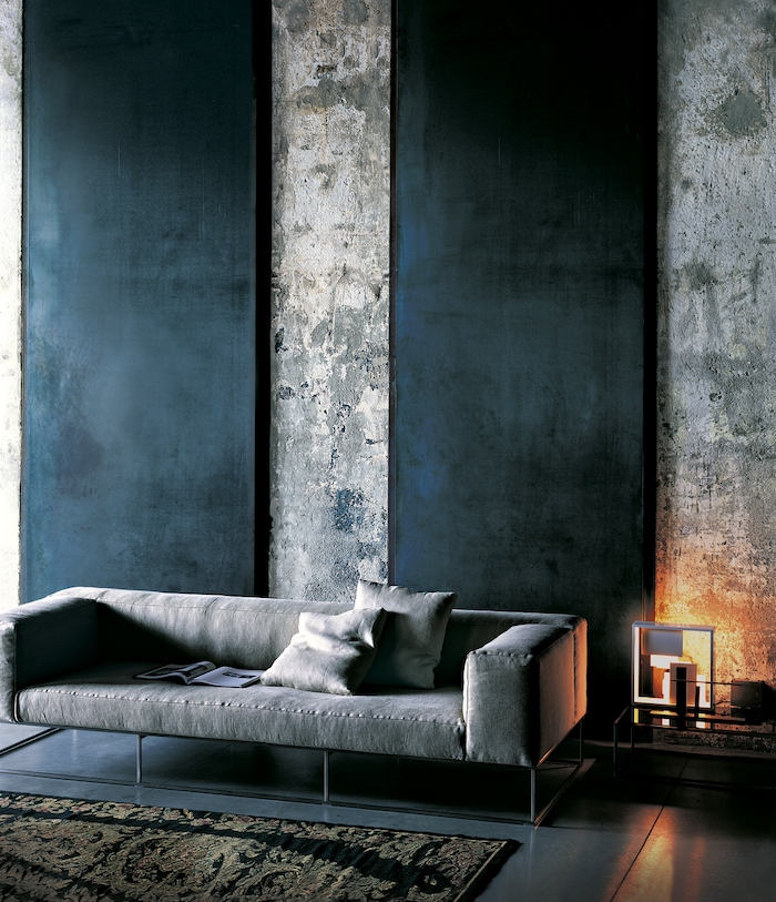 grey sofa with throw pillows, accent wall ideas for living room, grey cement and blue velvet wall installation