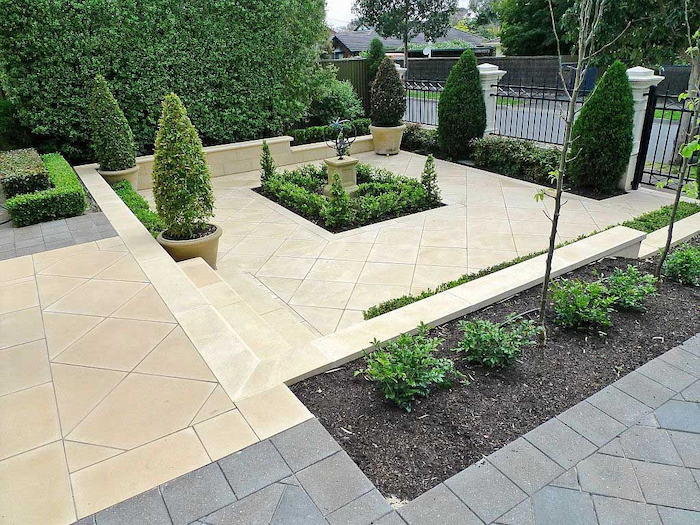 tiled floor, landscaping ideas for front of house, ceramic pots with trees, small hedges, patches of bushes