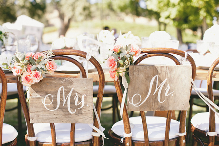 mrs and mr wooden tags on chairs, pink flower bouquets, wedding reception decoration ideas