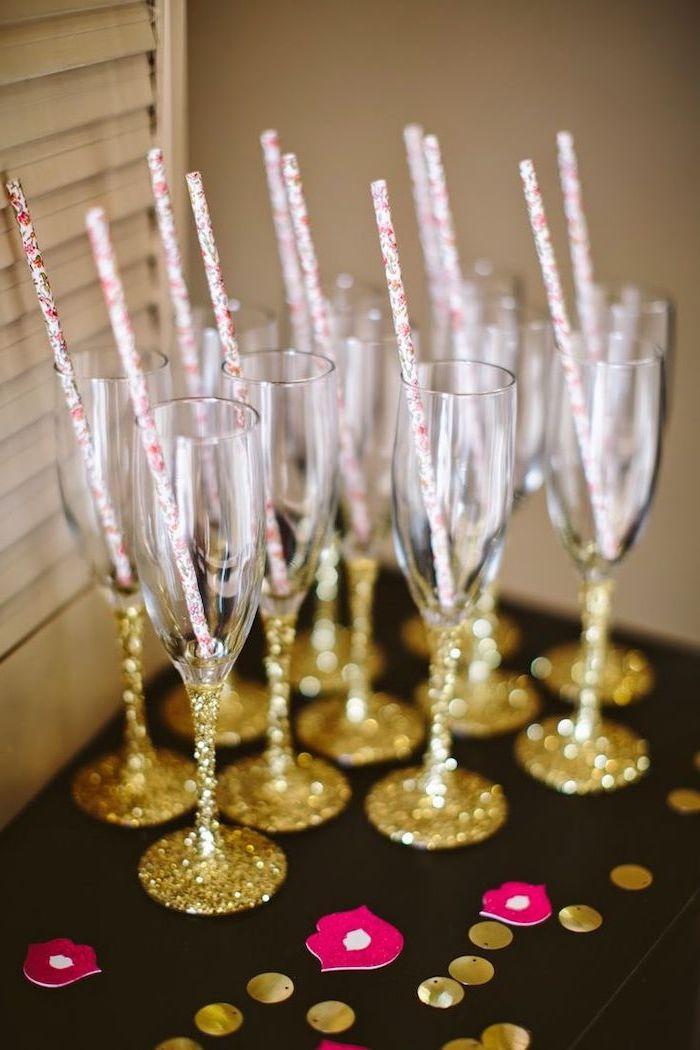 golden glitter, champagne flute, bachelorette games, paper straws, black table
