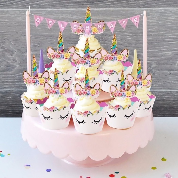 yellow buttercream cupcakes, rainbow coloured horns, pink cupcake stand, how to make a unicorn cake