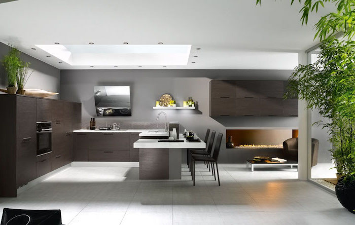 white tiled floor, white counters, kitchen wall decor ideas, dark wooden cabinets drawers and kitchen island