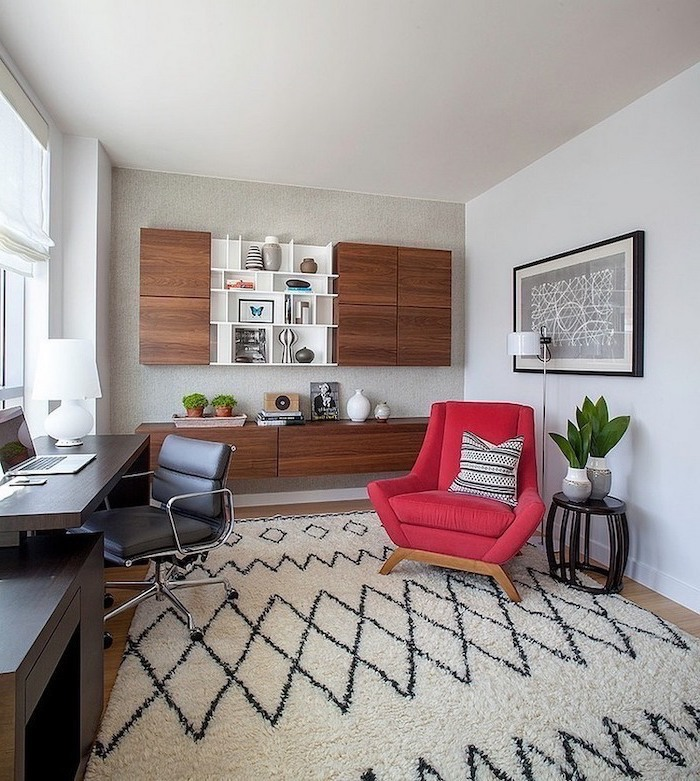 large red armchair, home office design, wooden bookcase with cupboards and shelves, black desk and leather chair