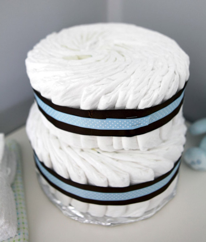 diaper cake, blue and black ribbons, baby shower themes, silver cake stand