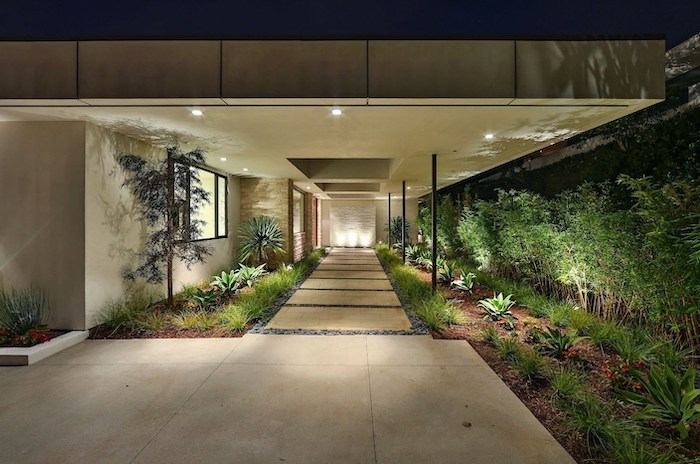 marble tiles entryway, tall trees, simple front yard landscaping ideas with pictures, patches of grass and bushes