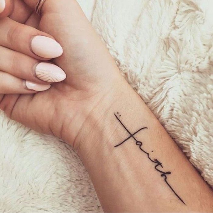 faith inscription, tattoos for women with meaning, pink nail polish, tattoo on the wrist, white fluffy blanket