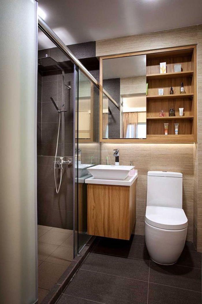 wooden floating shelf, bathroom renovation ideas, glass shower door, wooden shelves, black and beige tiled walls and floor