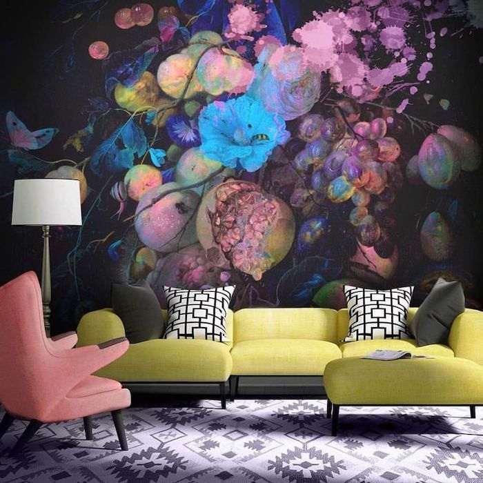 floral and fruits wallpaper, yellow corner sofa, pink armchair, accent wall, printed rug