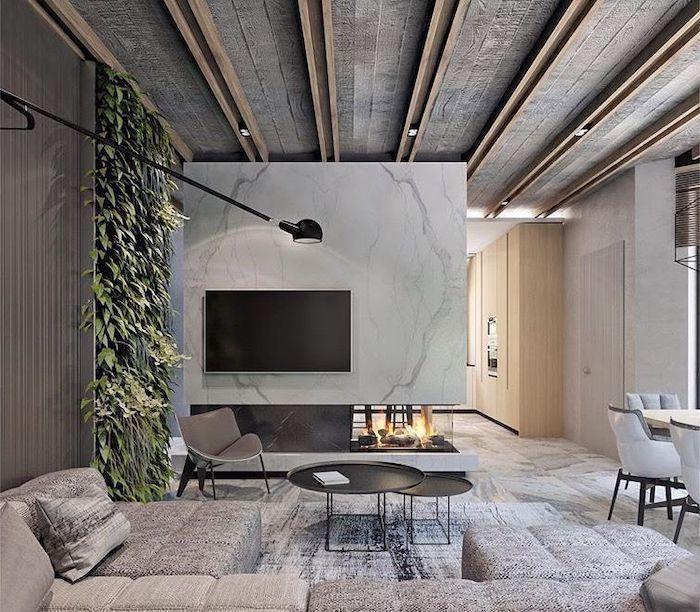 marble and greenery on the walls, accent wall ideas for living room, grey sofa, round coffee table