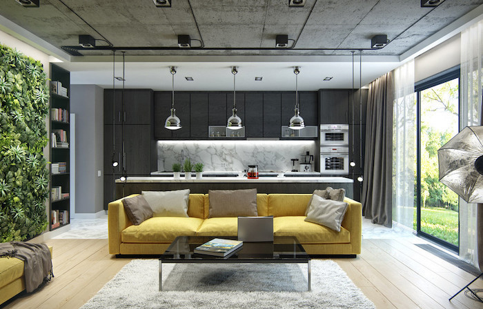 yellow sofa, greenery wall installation, black kitchen cabinets, accent wall colors, white rug