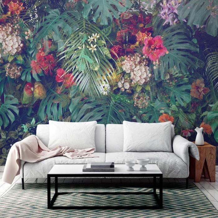 living room paint ideas, floral and palm leaves wallpaper, white sofa, green printed rug
