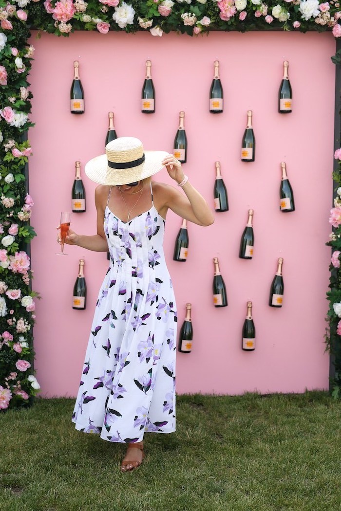 frame made out of flowers, floral dress, champagne bottles on a pink wall, bachelorette party games