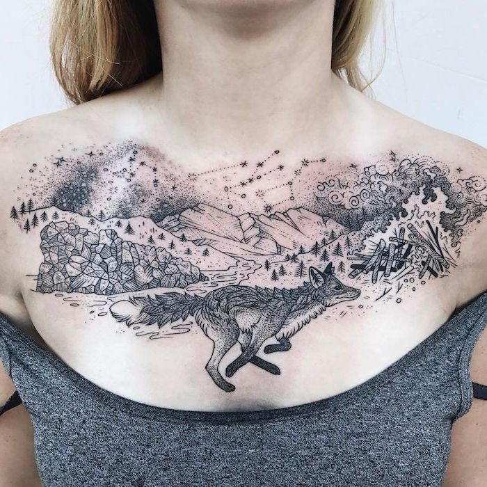 grey top, rose chest tattoo, wolf mountains trees and stars large tattoo, white background