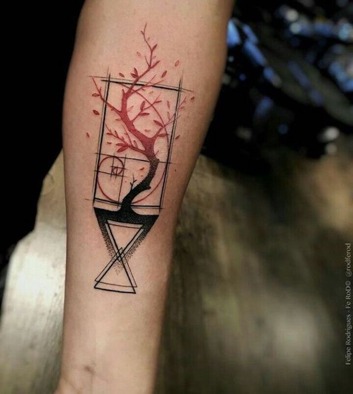 geometrical shapes with a tree, blurred background, simple tattoos for men
