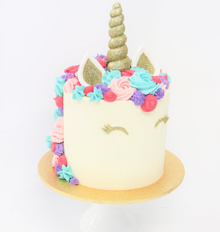 gold sprinkled horn and ears, diy unicorn cake, blue pink and red roses on white fondant