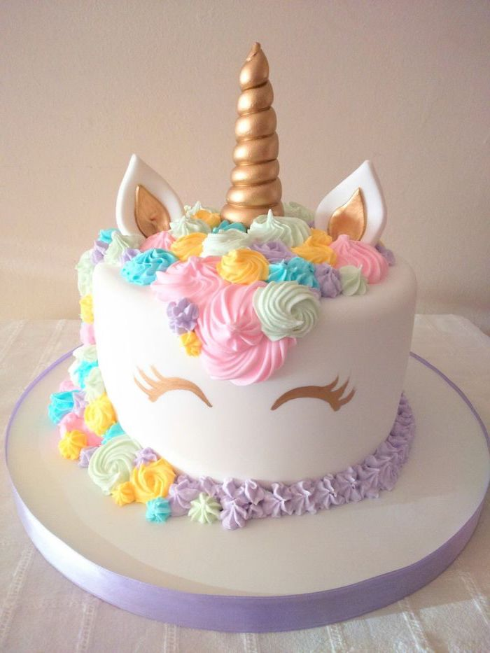 purple pink blue and yellow roses on white fondant, gold horn and ears, diy unicorn cake