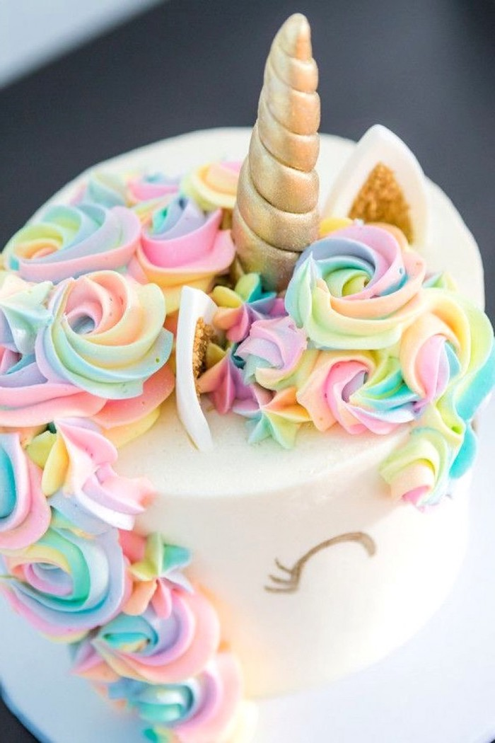 rainbow coloured roses on white fondant, gold horn and ears, how to make a unicorn cake