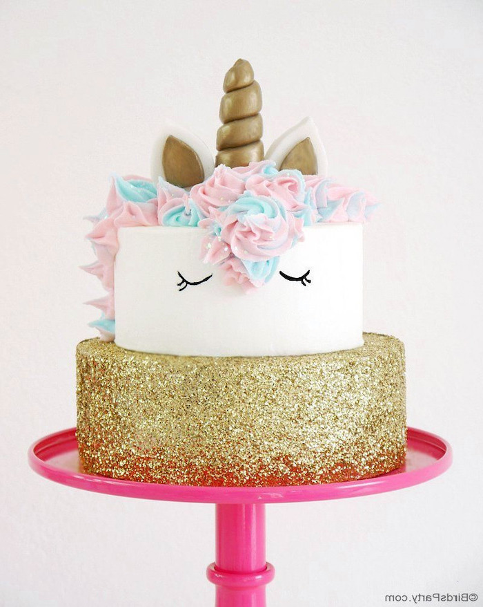 pink cake stand, gold sprinkled layer, pink and blue roses on white fondant, unicorn cupcake cake