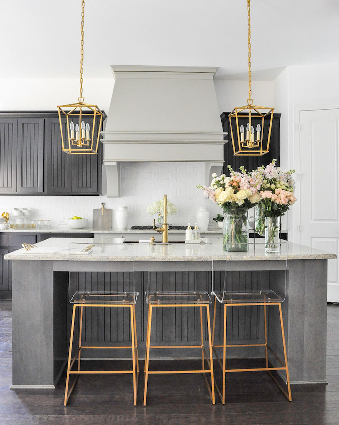 golden lantern chandeliers, gold and plastic bar stools, grey cabinets, kitchen cabinet design