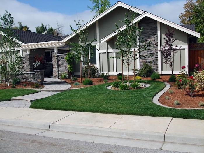 large patch of grass, front yard landscaping ideas, flower beds with bushes, small trees