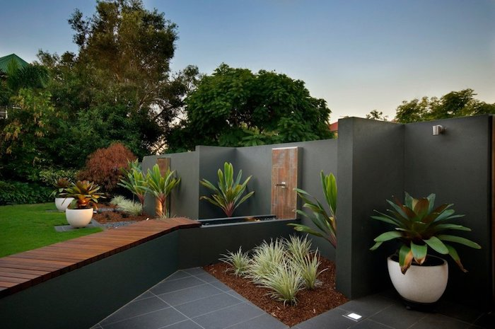 small flower beds with bushes, palm trees in ceramic pots, front yard landscaping ideas, grass patch, tall trees