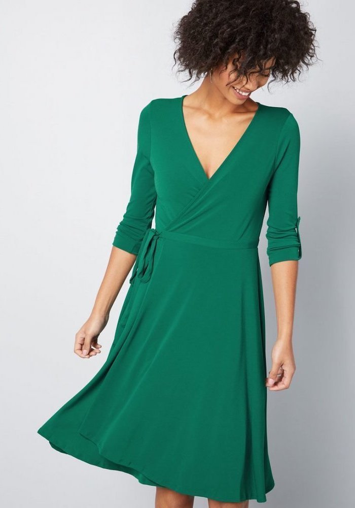 green hug me dress, short curly brown hair, business professional women