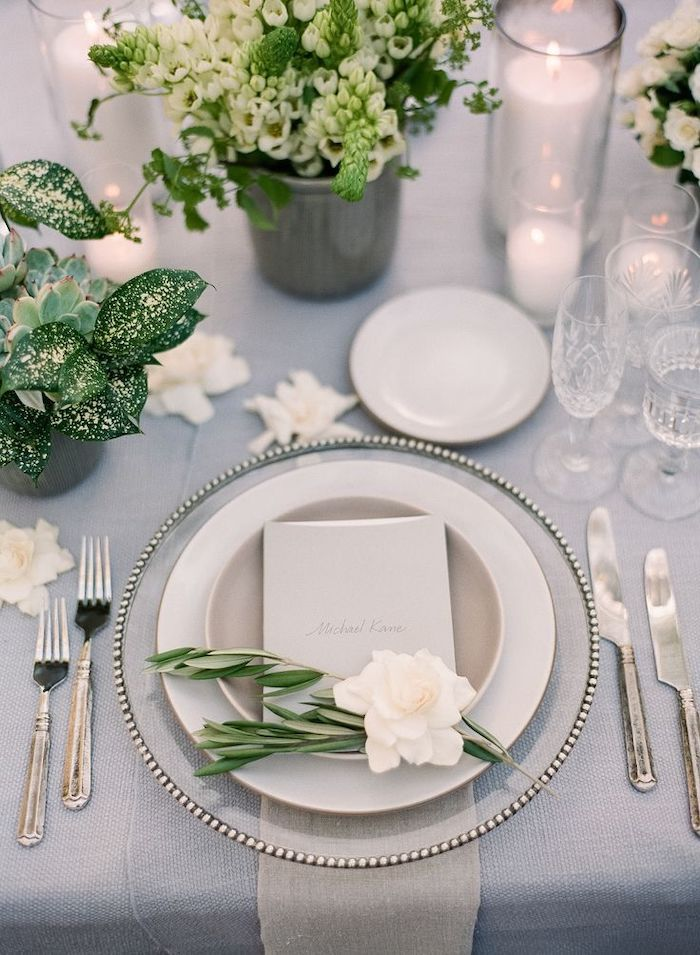 dinner set of plates and glasses, vases with white flower bouquets, outdoor wedding ideas