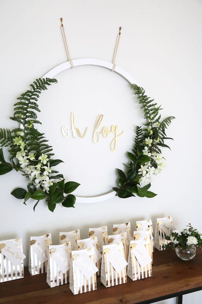 greenery and white flowers metal circle, goodie bags on the table, baby shower centerpieces boy